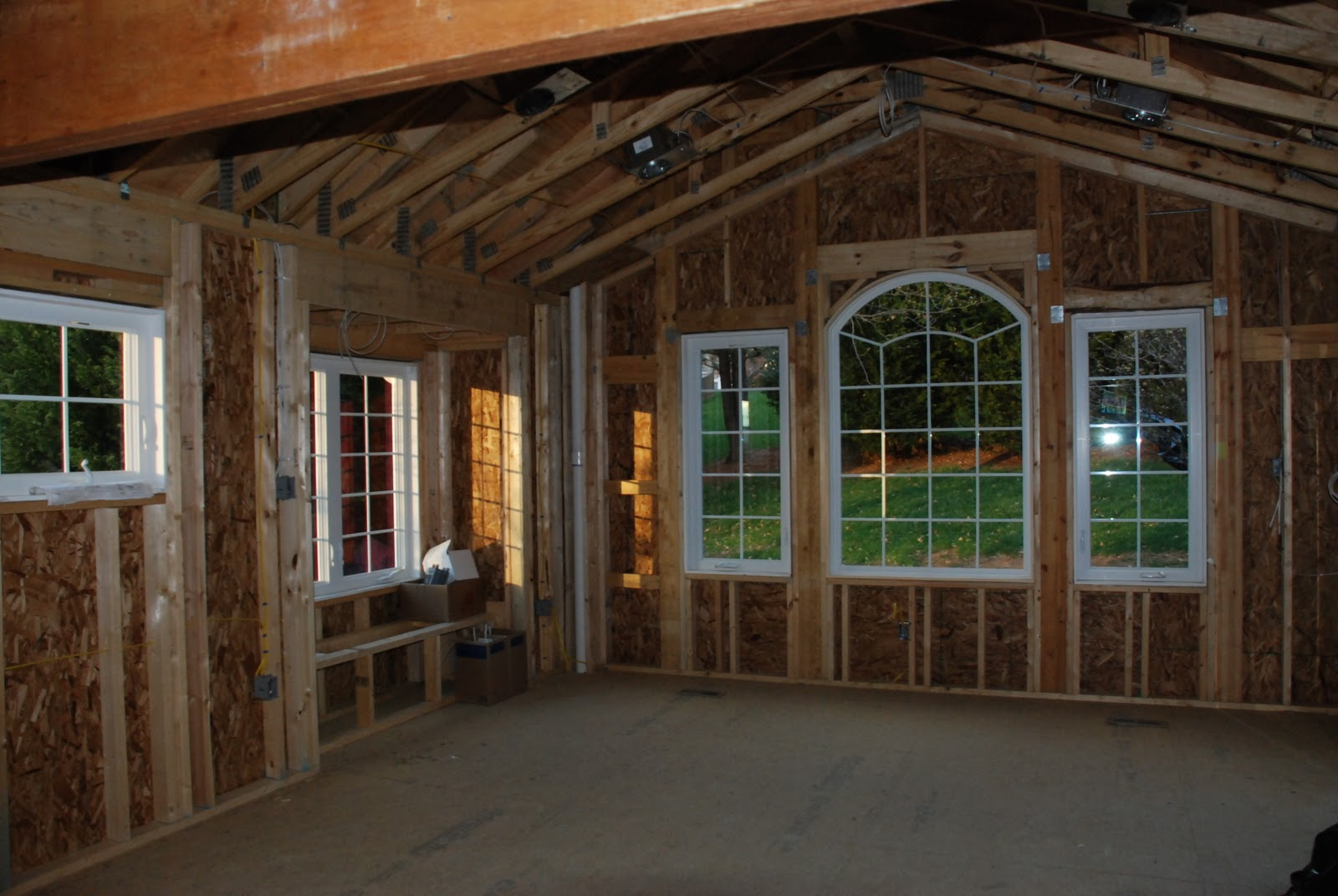 During:  the view from the original kitchen, under the new beam, out to the new breakfast room.  Check out the window seat to the left, already catching some morning sun.
