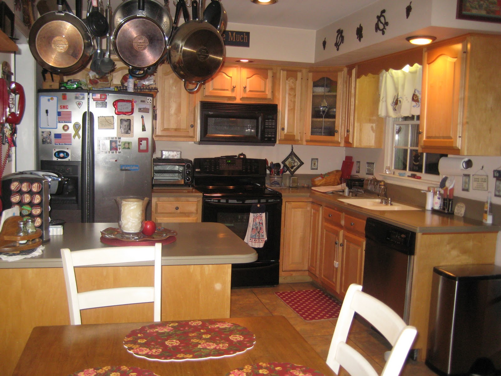 Before:  this kitchen is too small for the family, and they want to move the breakfast table out into a new breakfast room with lots of glass and a cathedral ceiling.  The entire back wall of the kitchen will be removed to enlarge the kitchen into the addition also.