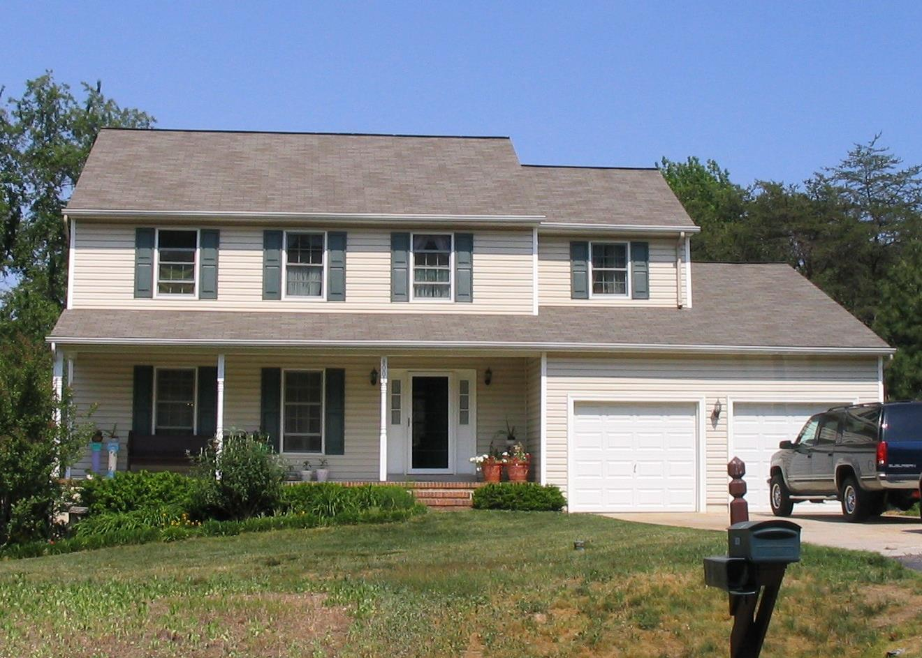 Before: the owners liked their house; they just wished there were more of it. Particular needs were: a music room, an in-law suite, a basement level storage bay for the boat, and an upper level open rec room with its own steps (i.e., not accessible from the rest of the second floor).