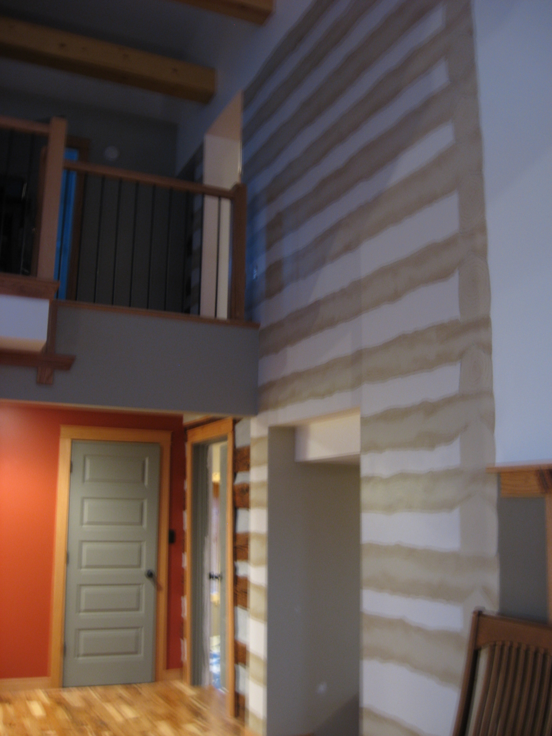 After:  a section of the actual log wall has been left visible next to the trompe l'oeil.