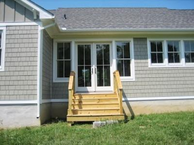 These steps are temporary. Once they're ready the clients will contact me to design a screened porch addition with a grilling deck to the side.