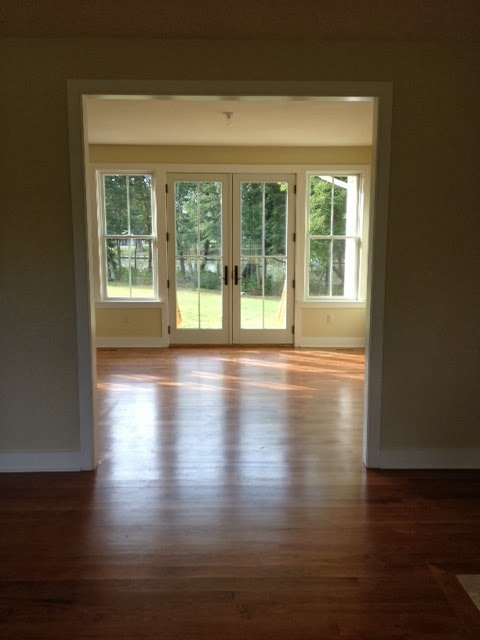 Picture taken from the living room, through the dining room and out the french doors to the back yard (and the water!)