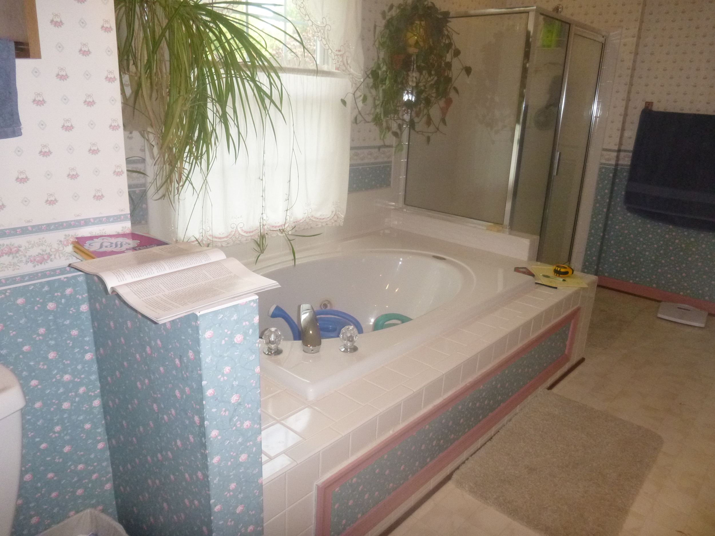 Before: the master bath tub was oversized and underused, while the constantly-used shower was too small.