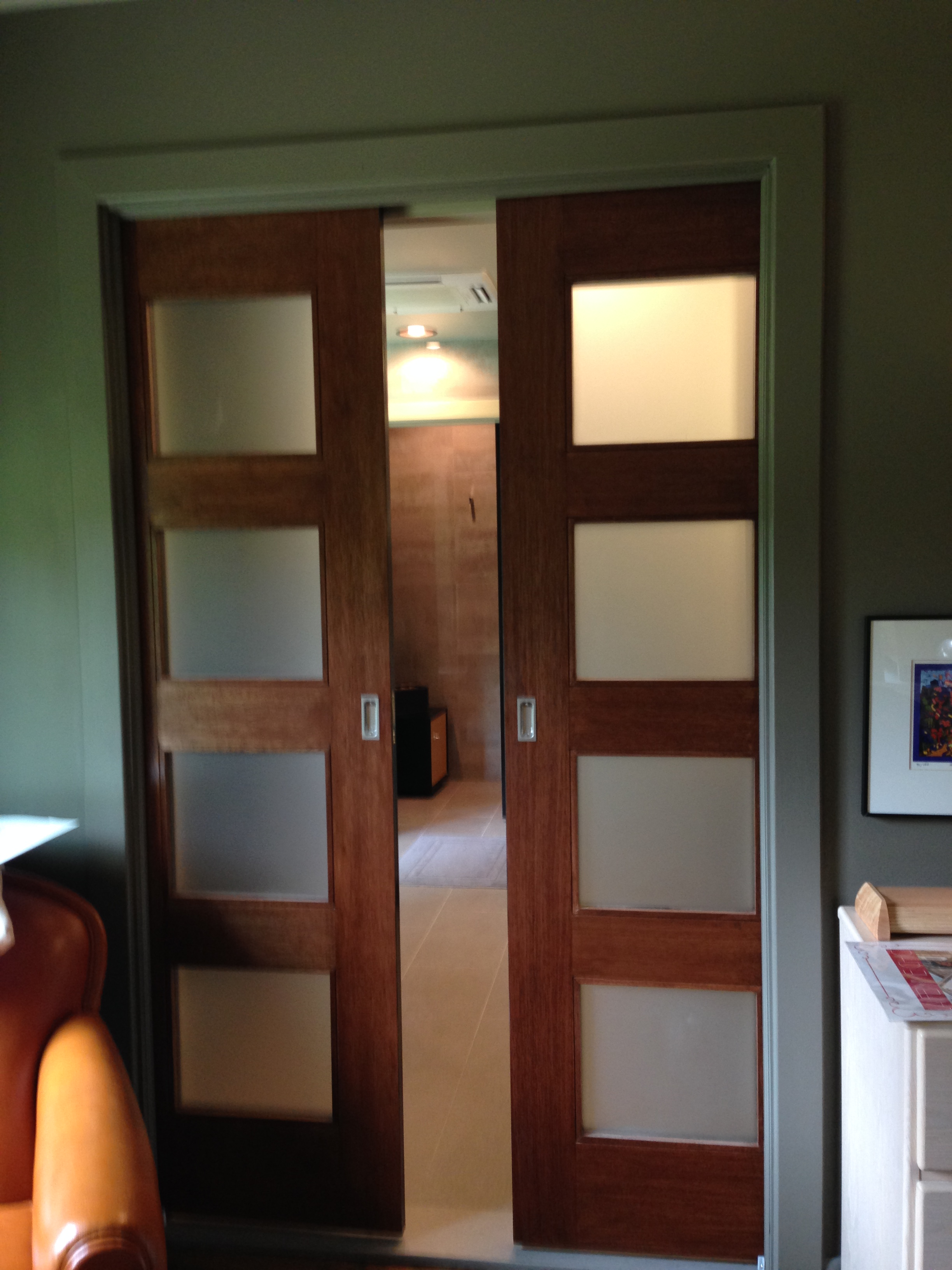 AFTER:  The entry has been widened to 4', and two pocket doors have been installed in a new 2x6 partition (the old 2x4 wall was removed).