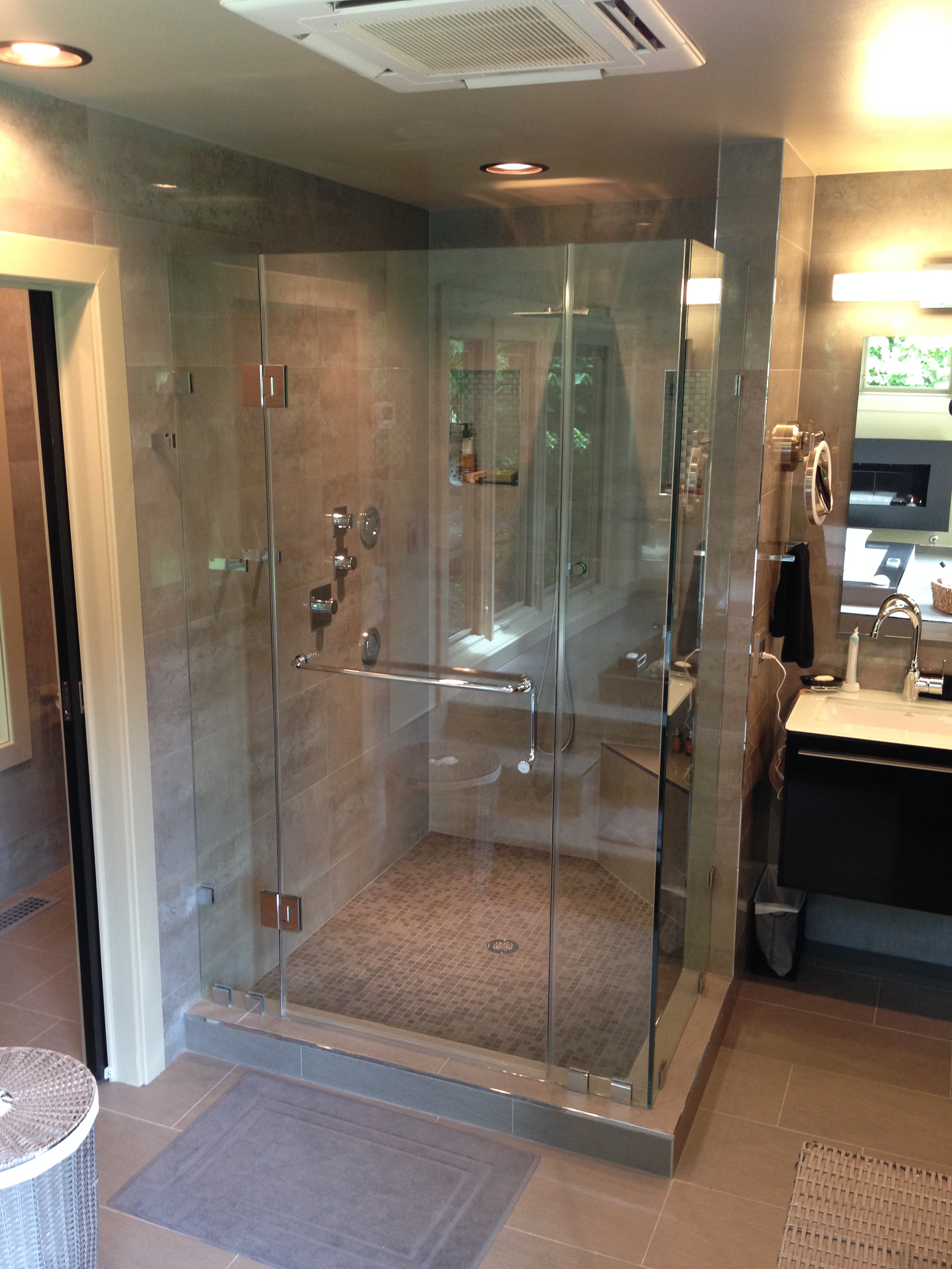 AFTER:  new shower with body sprays, rain shower head, shampoo niches, and corner seat.  Luxury!