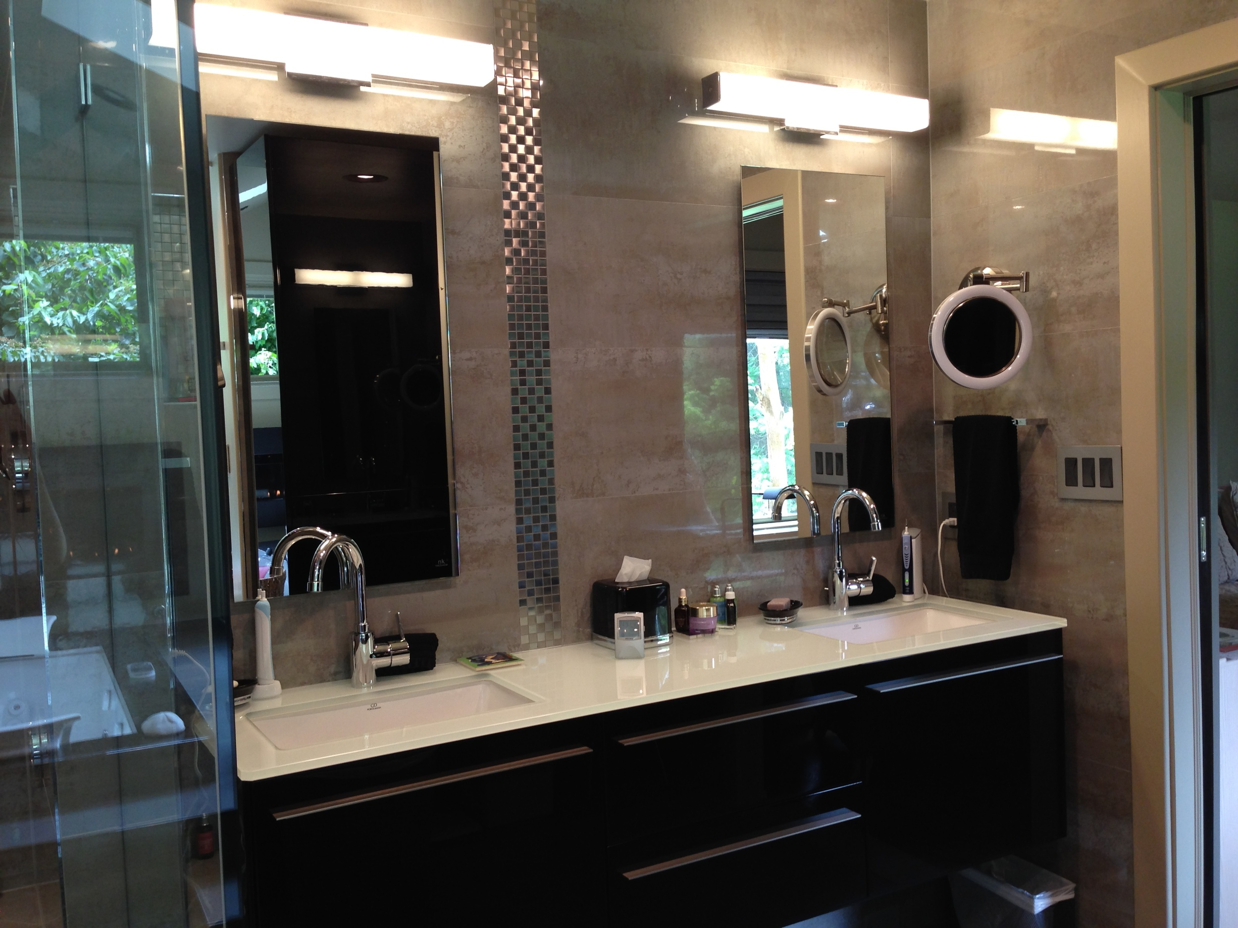 AFTER:  new wall-hung vanity by Porcelanosa in the same location as the old one.