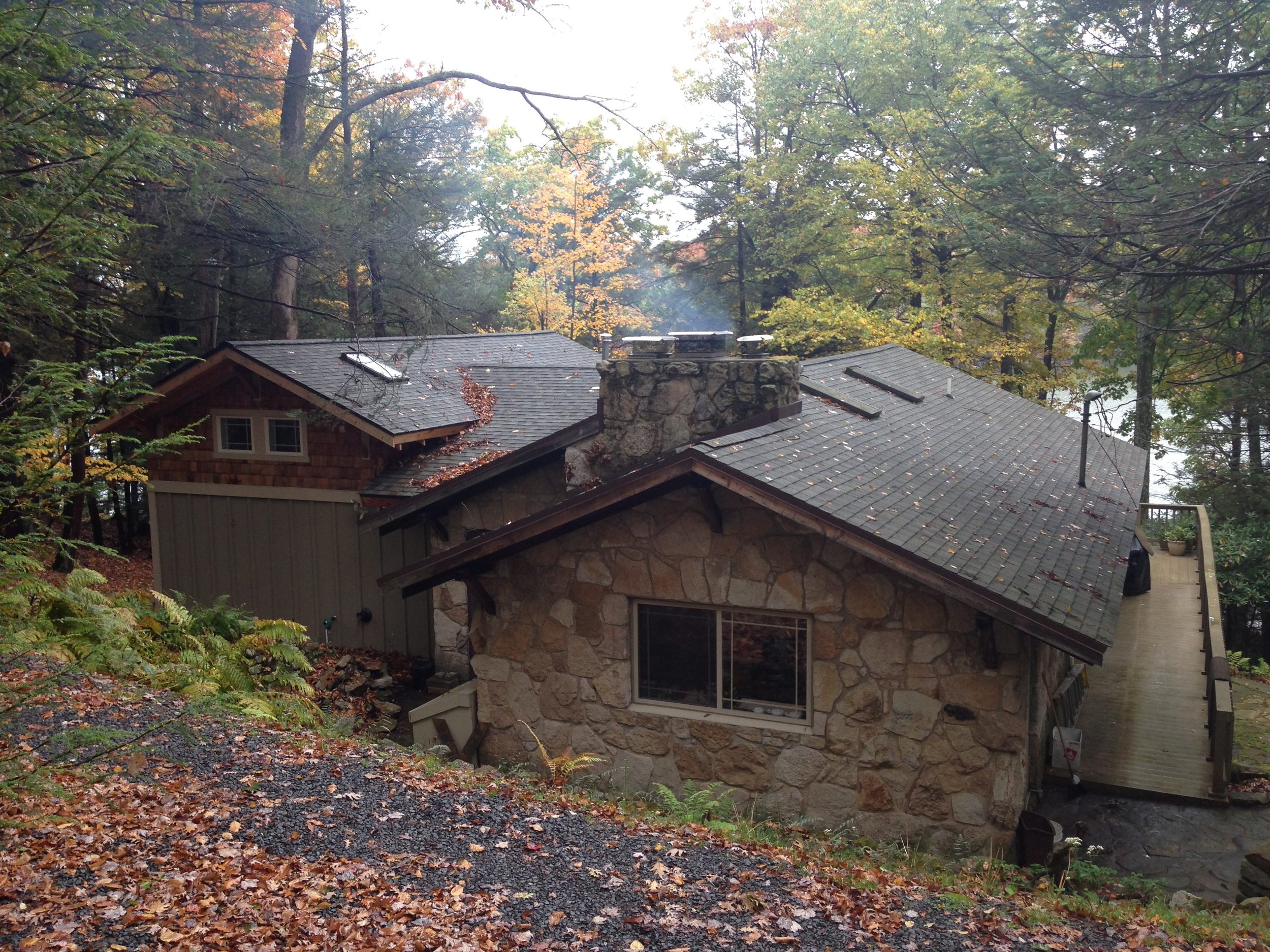 View from the driveway. The original house is on the right. Note how the roof pitches of the new addition complement the existing.