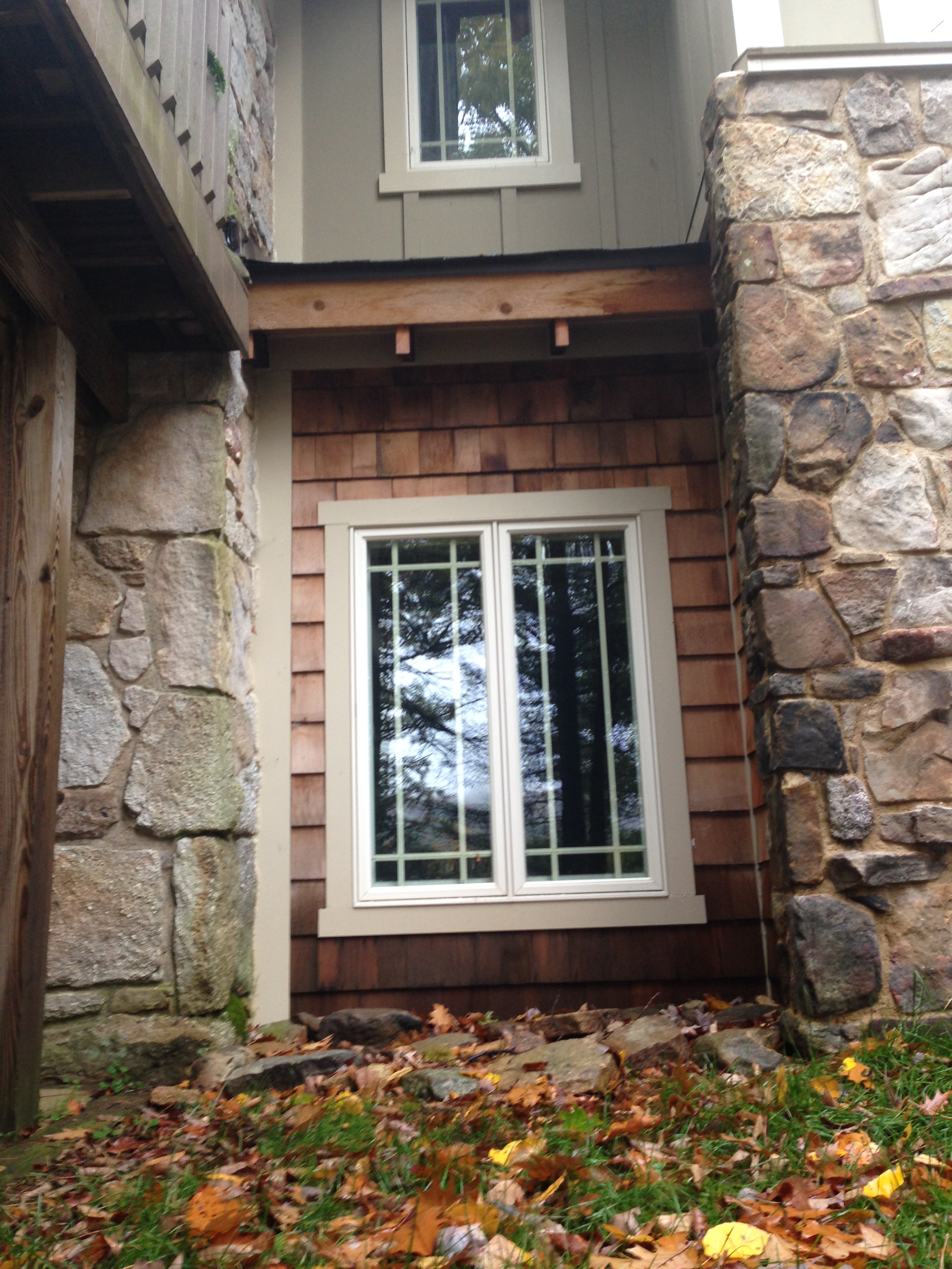 This is the window at the end of the basement hall, in the photos with the decoys.
