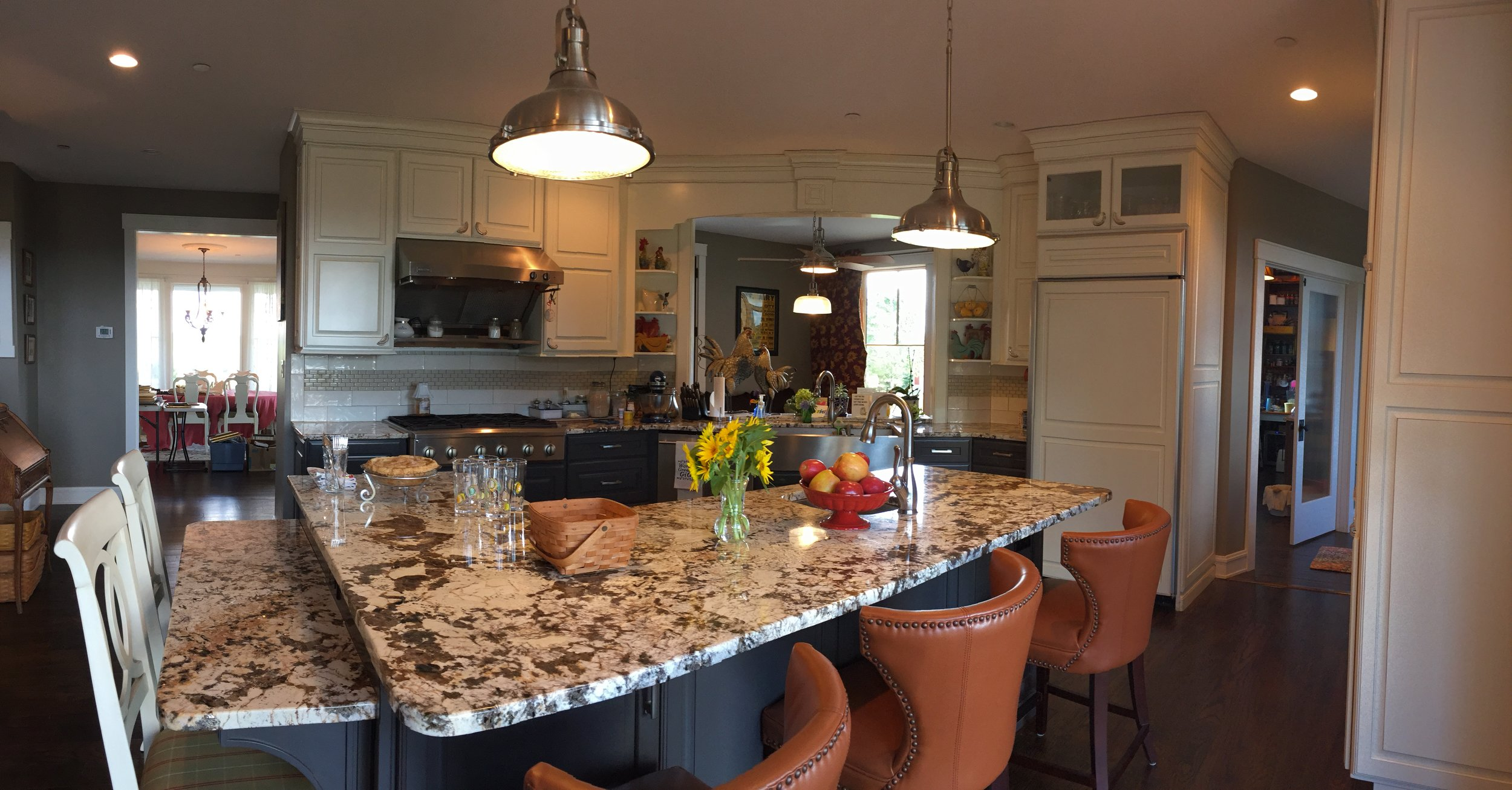 Two seating heights at the kitchen island, for visitors of various ages or levels of mobility.