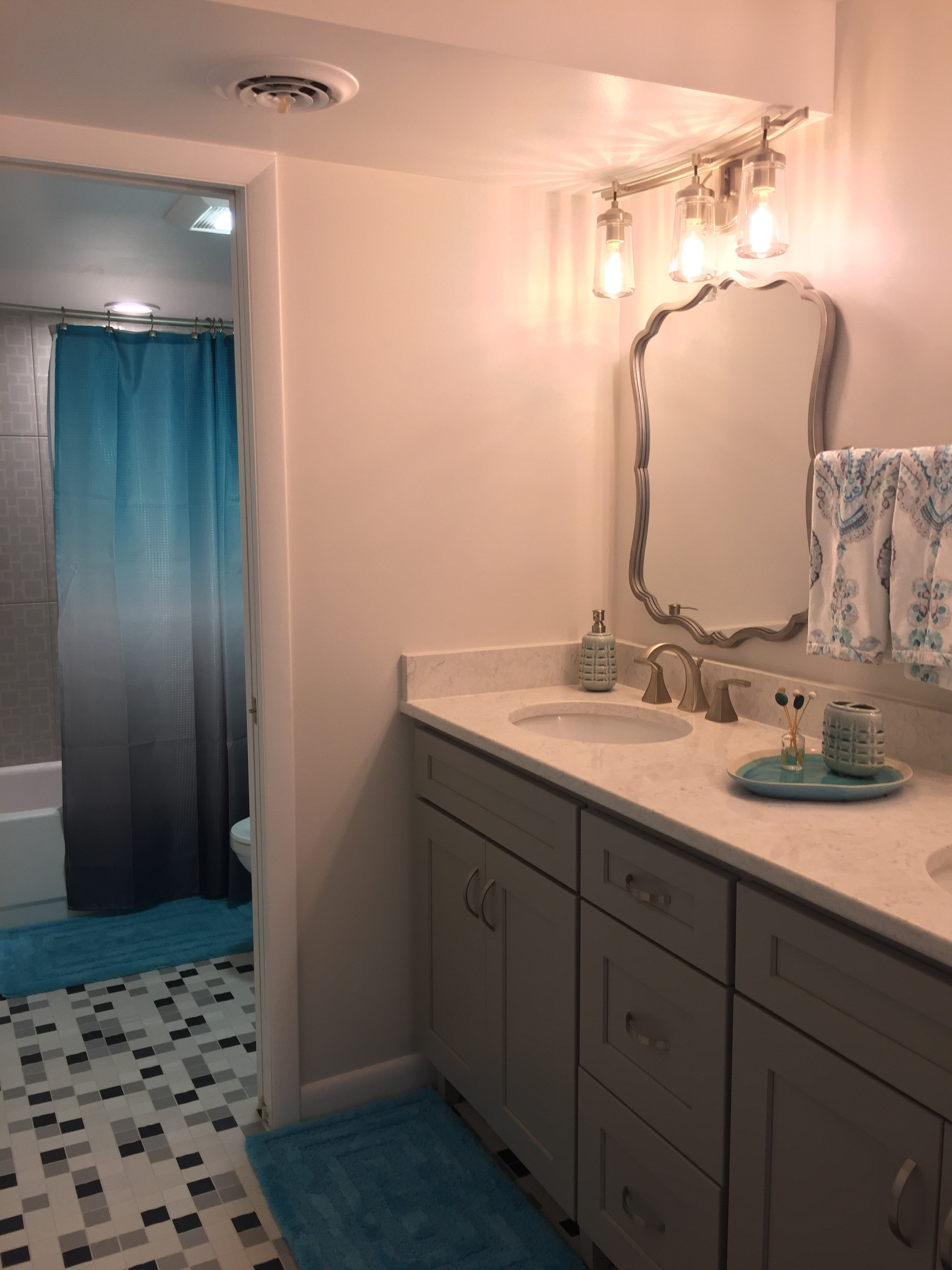 After, a new wall and door separate the vanities from the toilet/tub area.