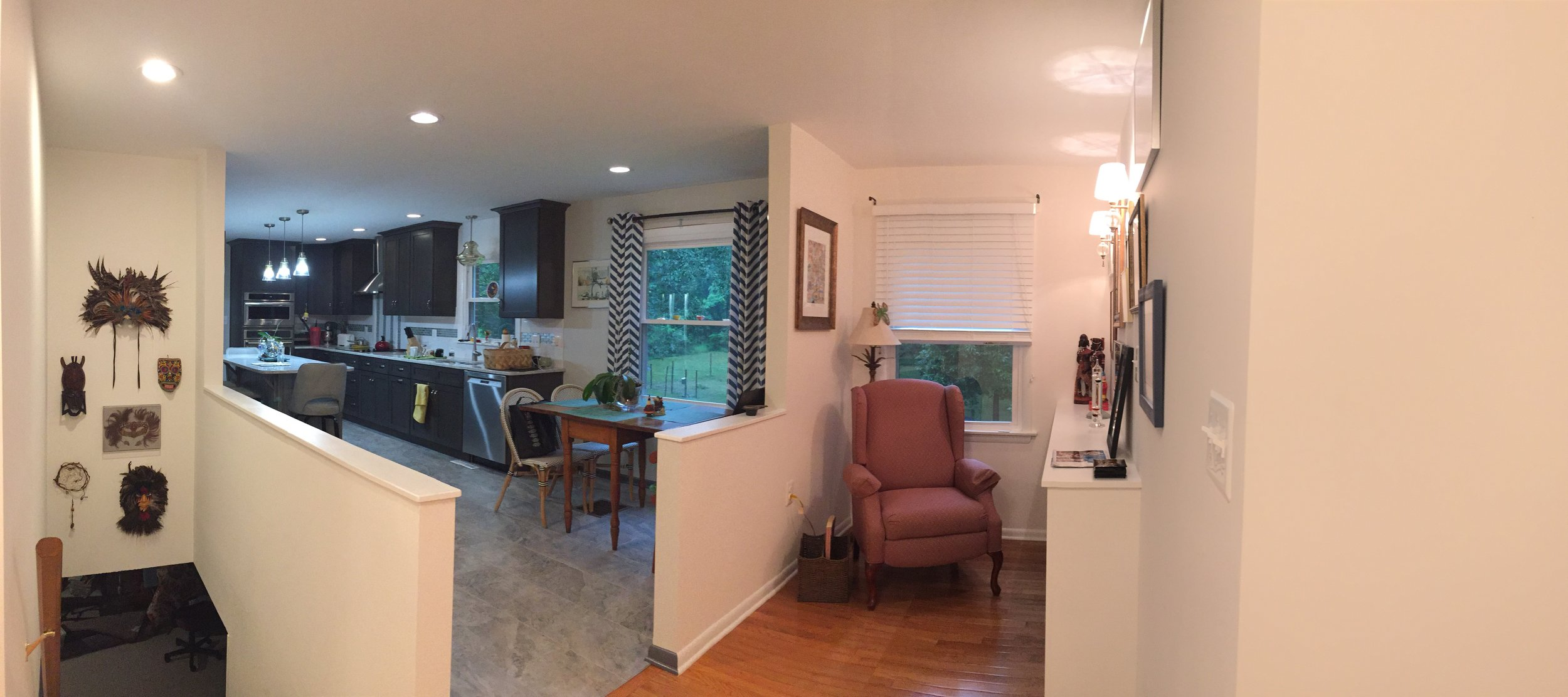 After, the former Living Room window is now part of a great little reading nook. Walls have been removed at the basement staircase and between the former Living Room and the Kitchen. This is the view as one enters from the Foyer.