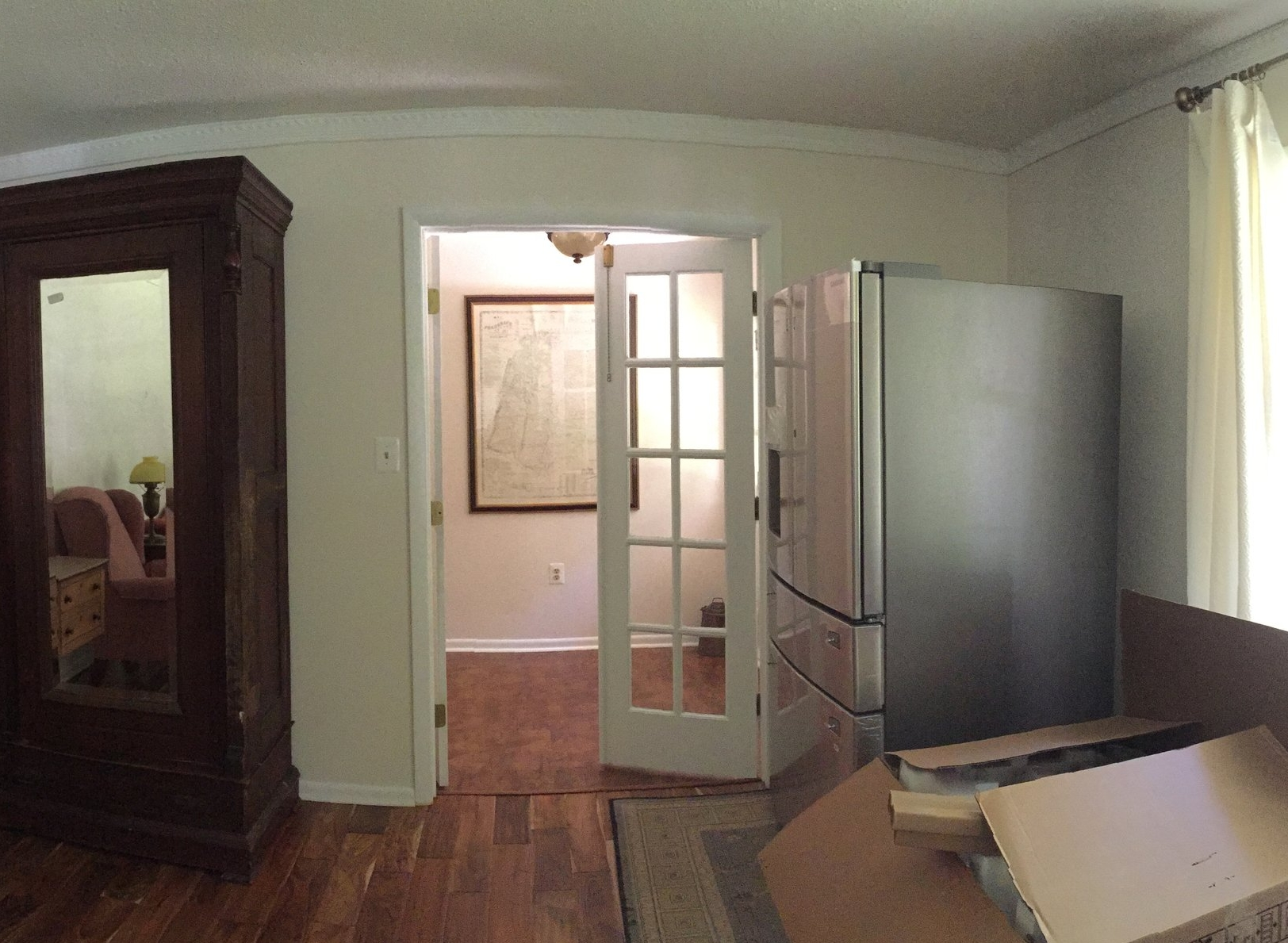 Before, the Family Room doors leading into the Foyer beyond swung into the foyer.