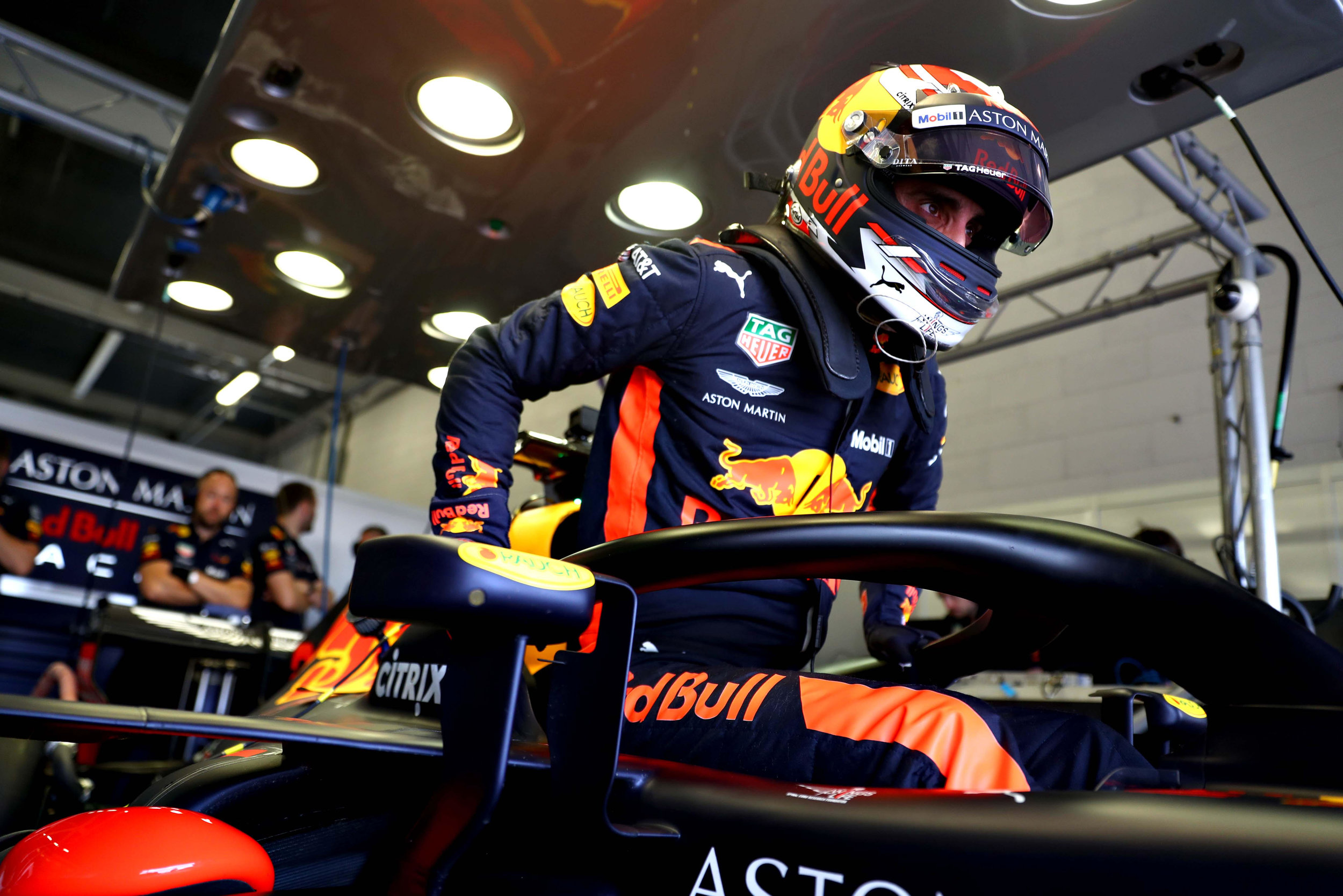 Helmart official driver Sebastien Buemi aboard the Red Bull Racing F1 car.