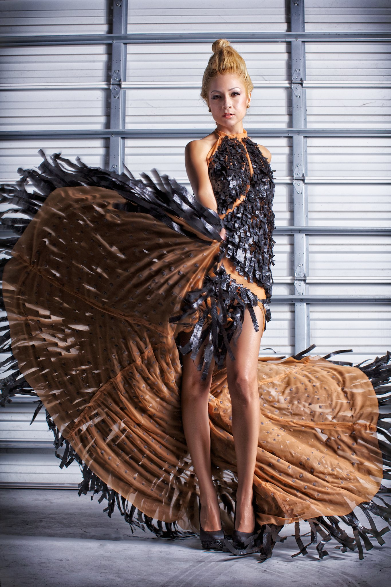 Fashion designs by Mariapia Malerba, made entirely from recycled material.