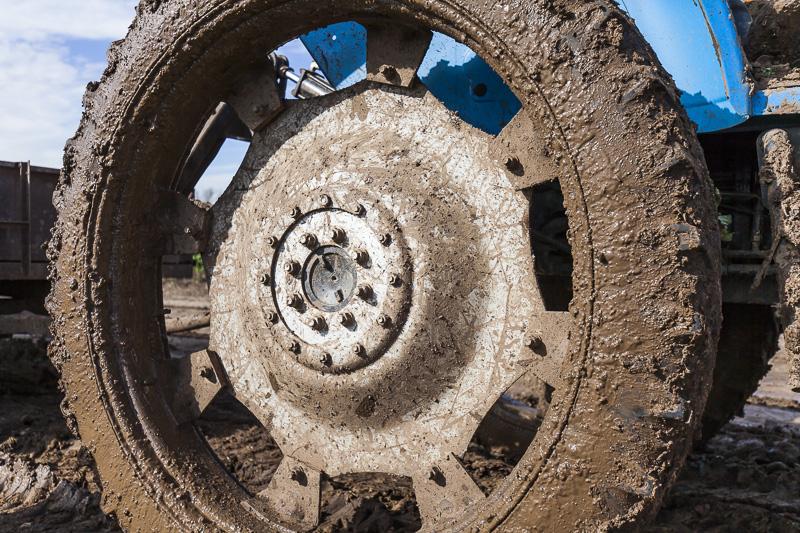 Muddy tractor tire at Johnson's Backyard Garden, Austin, TX.