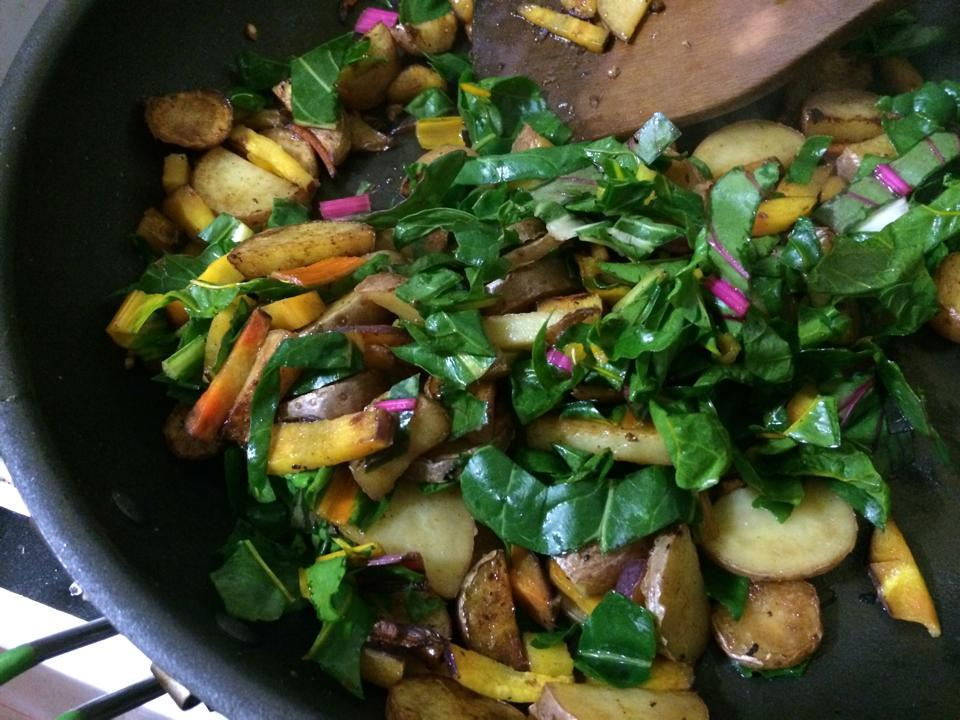 Garden fresh hash. Fingerling potatoes, carrots, garlic and rainbow shard combine to make a perfect breakfast or dinner. Top this bad boy with Vibrant Veggies' Morrocan Fusion kraut and you've got a winner!