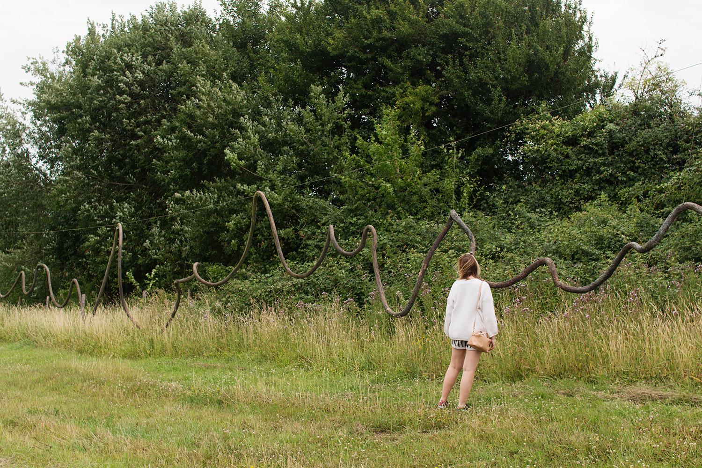 Charline looking at an installation called 'Twijfelgrens' by Fred Eerdekens in Borgloon, Belgium