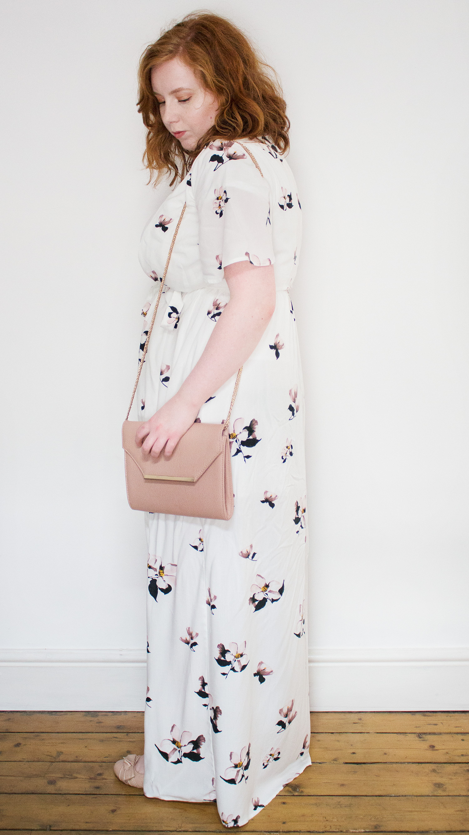 Woman in white floral maxi dress