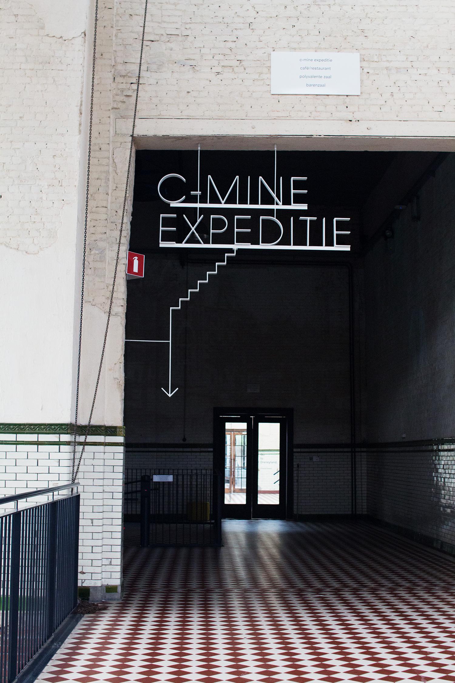 C-mine expeditie sign in dark corridor, Genk