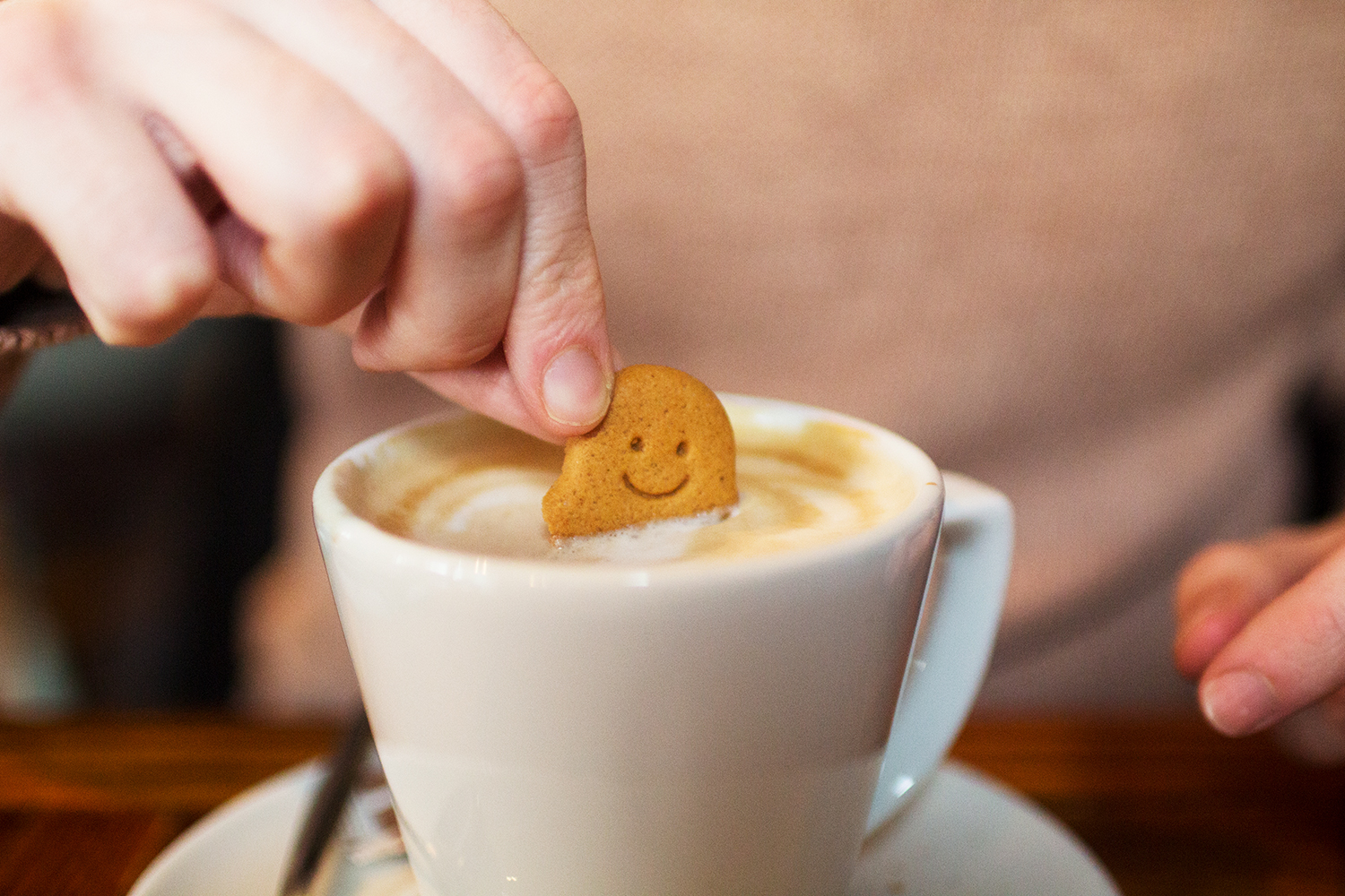 Biscuit being dunked in coffee. The Rope & Anchor, Altrincham. Photography by Alice Red.