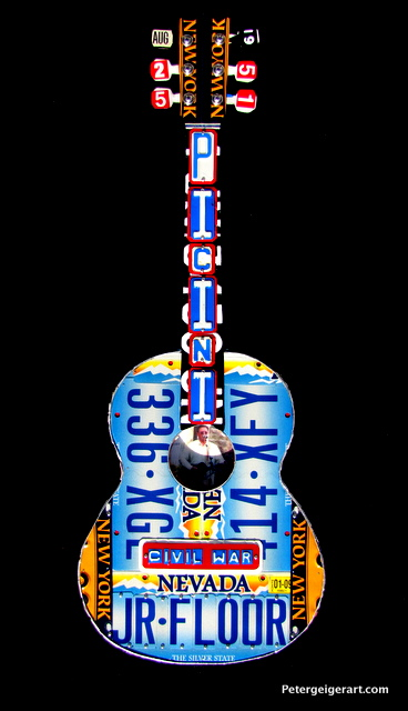 A Civil War buff is the recipient of this Nevada themed guitar. it features his family's lastname on the neck.