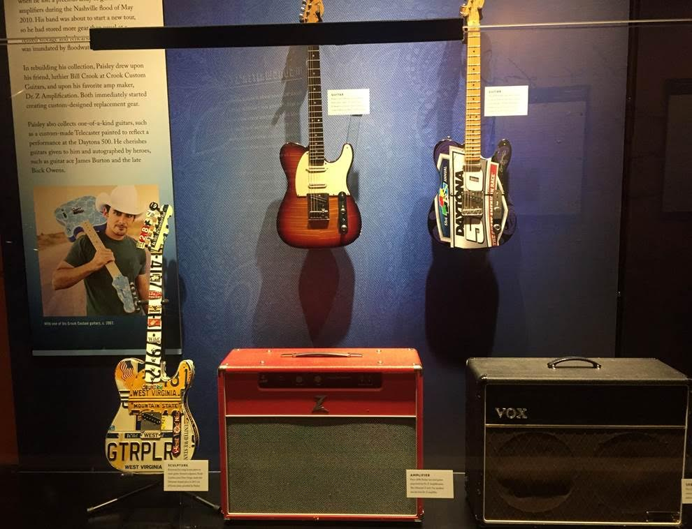 The license plate guitar I created for Brad Paisley hands in the Country Music Hall of Fame.