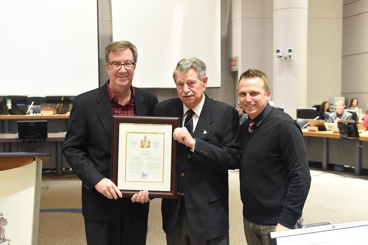 Rideau-Goulbourn resident, Peter Ryan, receiving Mayor Jim Watson's City Builder Award with Councillor Moffatt at November 25, 2015 Council Meeting.