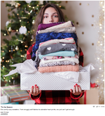 Image of Target Holiday Ad Girl holding pile of clothes in a gift box