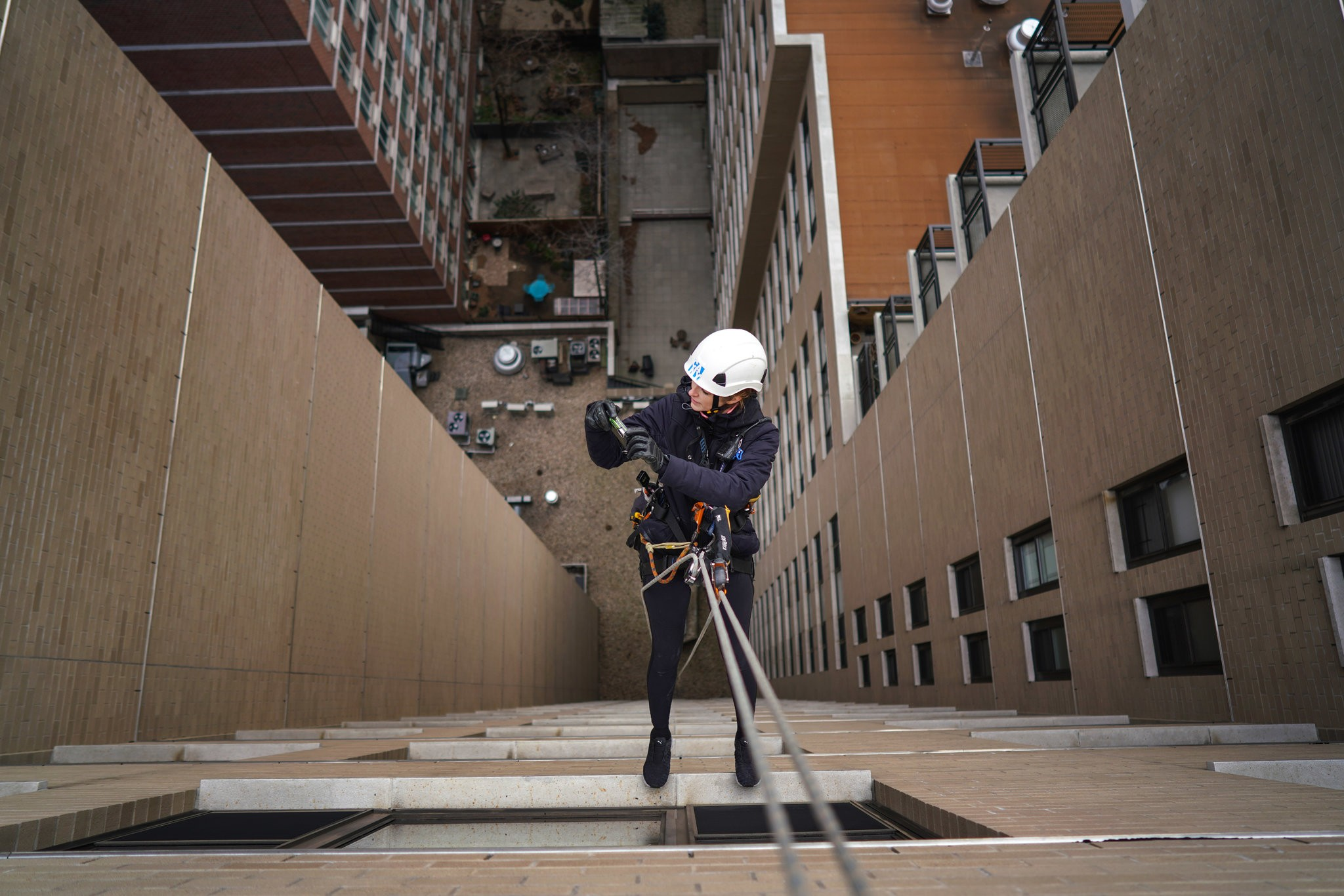 "The New York Times - ""The Building Inspector as Action Hero"" -A growing number of building facade inspectors, increasingly women, are rappelling into New York City's glass and terra-cotta canyons."