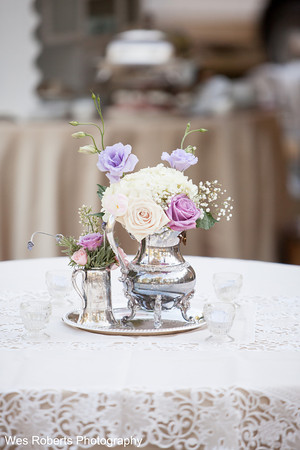 Gorgeous centerpieces in antique silver tea sets.