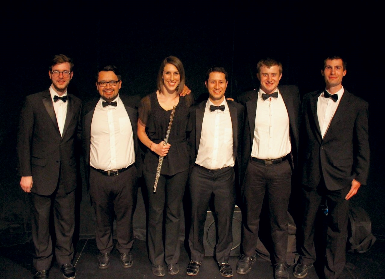 "Catherine and other ""aging out"" musicians from the Debut Orchestra. From the left: John Shawger (french horn), Alex Rosales Garcia (bassoon), Catherine Baker (flute), Benjamin Adler (clarinet), Jake Kraft (trombone), and Thomas Lovasz (cello)."