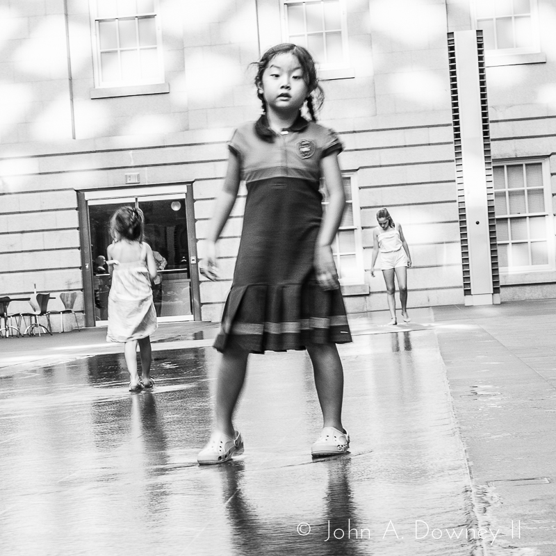 A girl pauses to assess the photographer.  National Portrait Gallery Atrium, 2013.