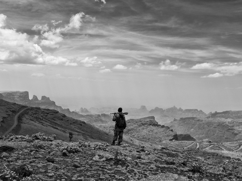 Endalk, one of our scouts, surveys a jagged valley below the Simien peaks in northern Ethiopia.