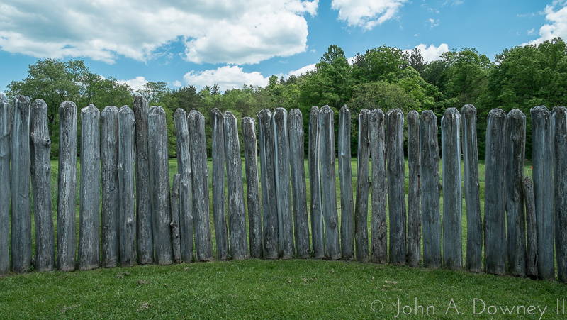 Through the fence posts, the enemy would have been visible at the tree line.