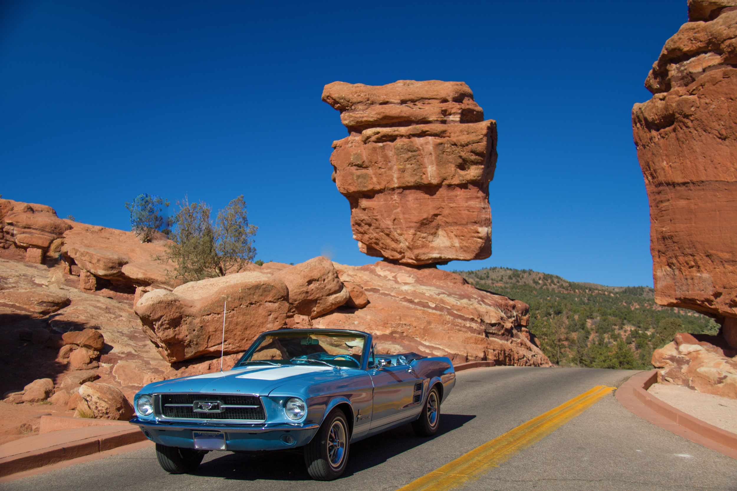 Darn that man and his Mustang... wait, they made the shot better!  At Balancing Rock in Garden of the Gods, Colorado Springs, Colorado.