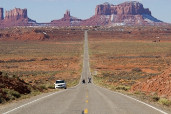 A couple takes a selfie along the famous Rt. 163 into Monument Valley, Arizona. Road trips like this are a great excuse for taking lots of family pictures and fun selfless.