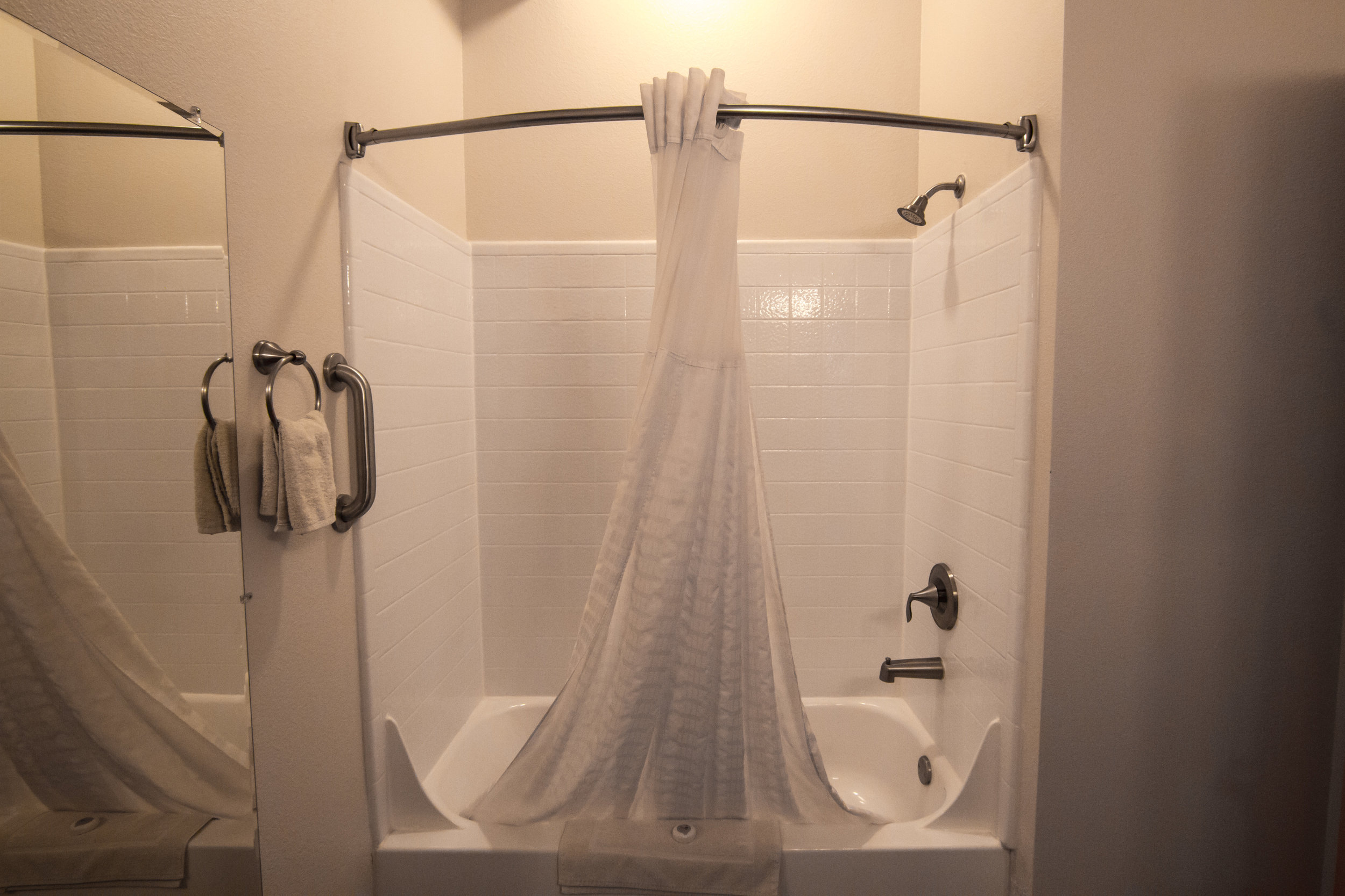 Nice, big, clean bathrooms with a shower and tub and large vanity are in all the rooms at The View Hotel.