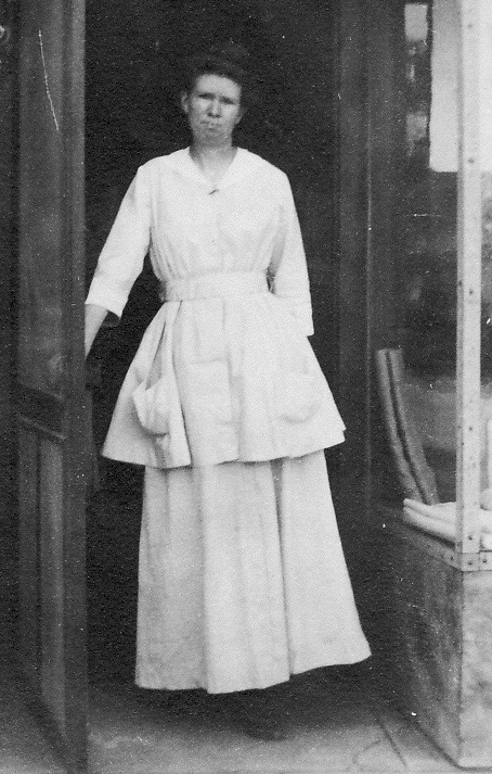 Mamie Sala in front of her needlework store, Gridley California
