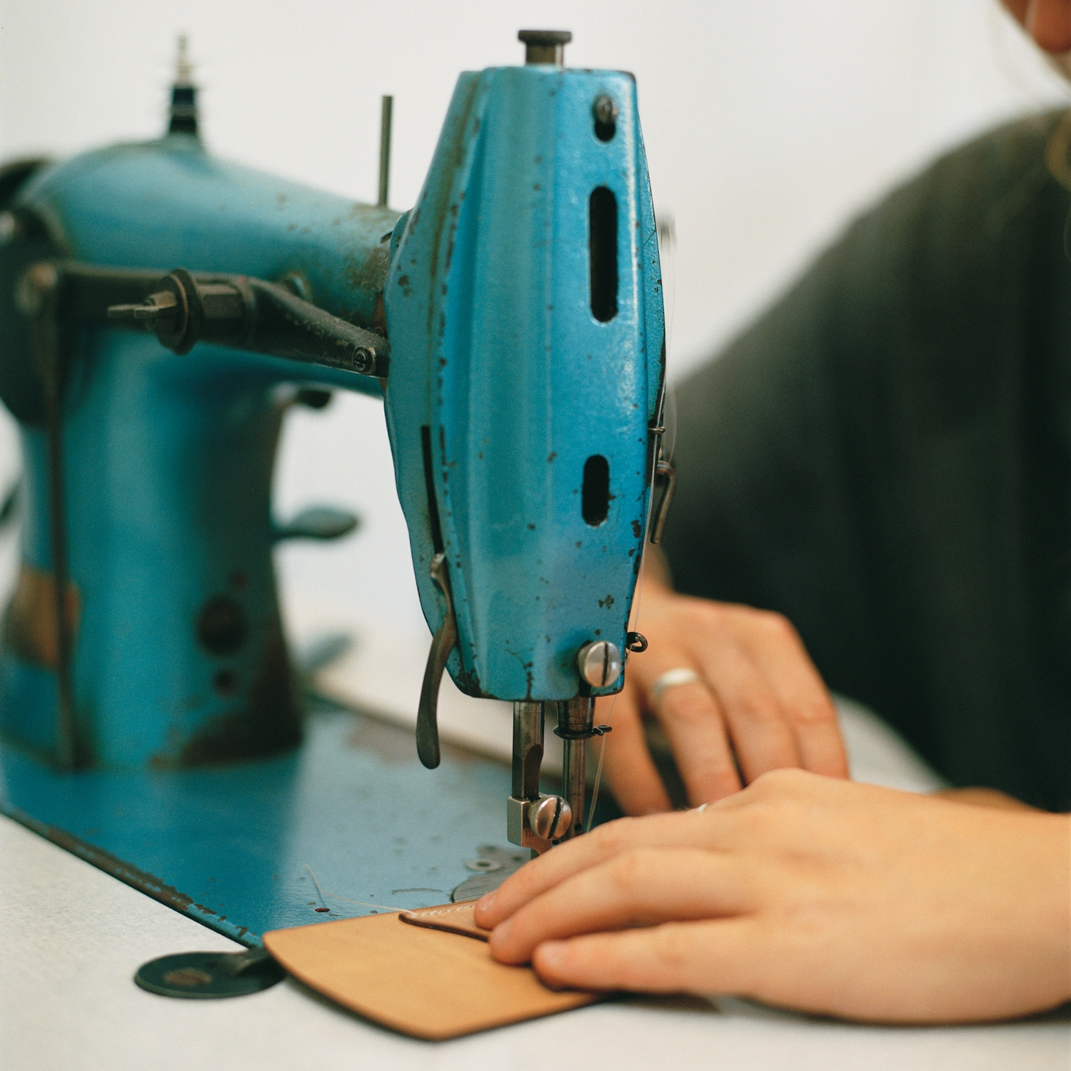 3. Using our 1930s Singer flatbed the card holder, neck loop and sides are carefully stitched together