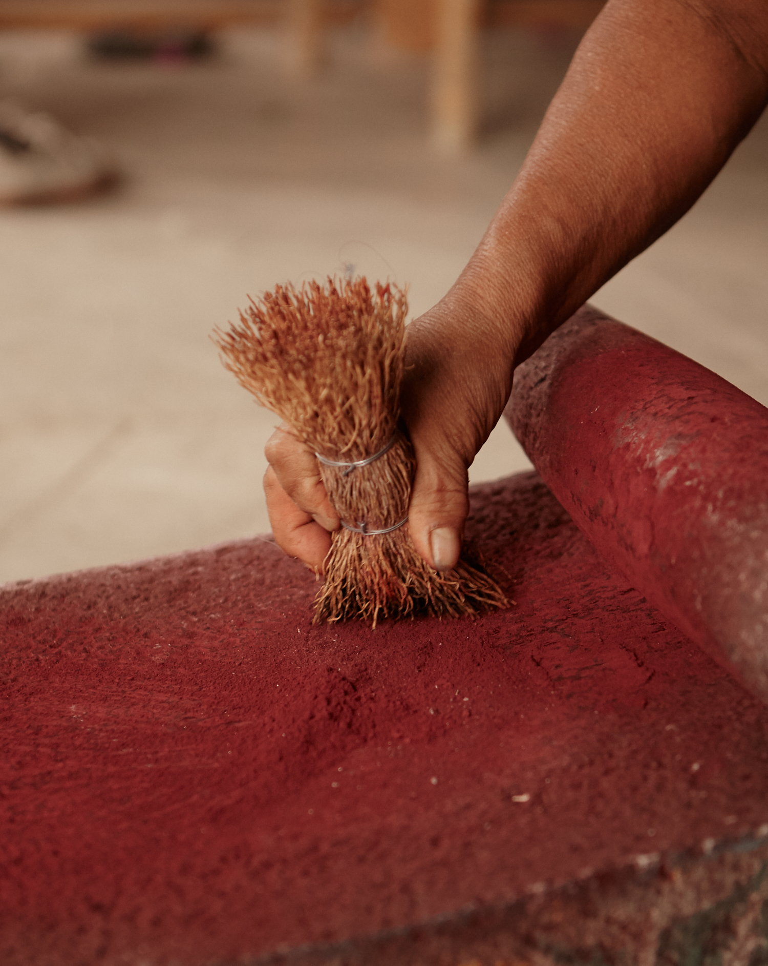 A rhythmic process of grind, brush, grind until the cochineal is a fine enough powder for the dye bath