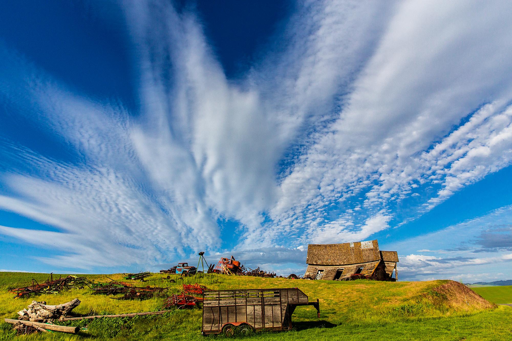 Palouse farm house wild clouds.jpg