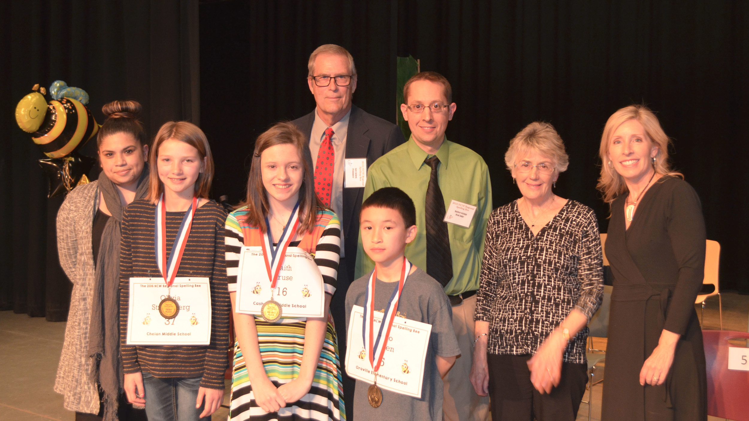 Students from right to left: Champion Leo Chen, 2nd place Faith Kruse and 3rd place Olivia Strandberg. Also shown are event officials Missy Raymond,  Gary Jasinek , Matthew Ockinga  and Geraldine Warner.