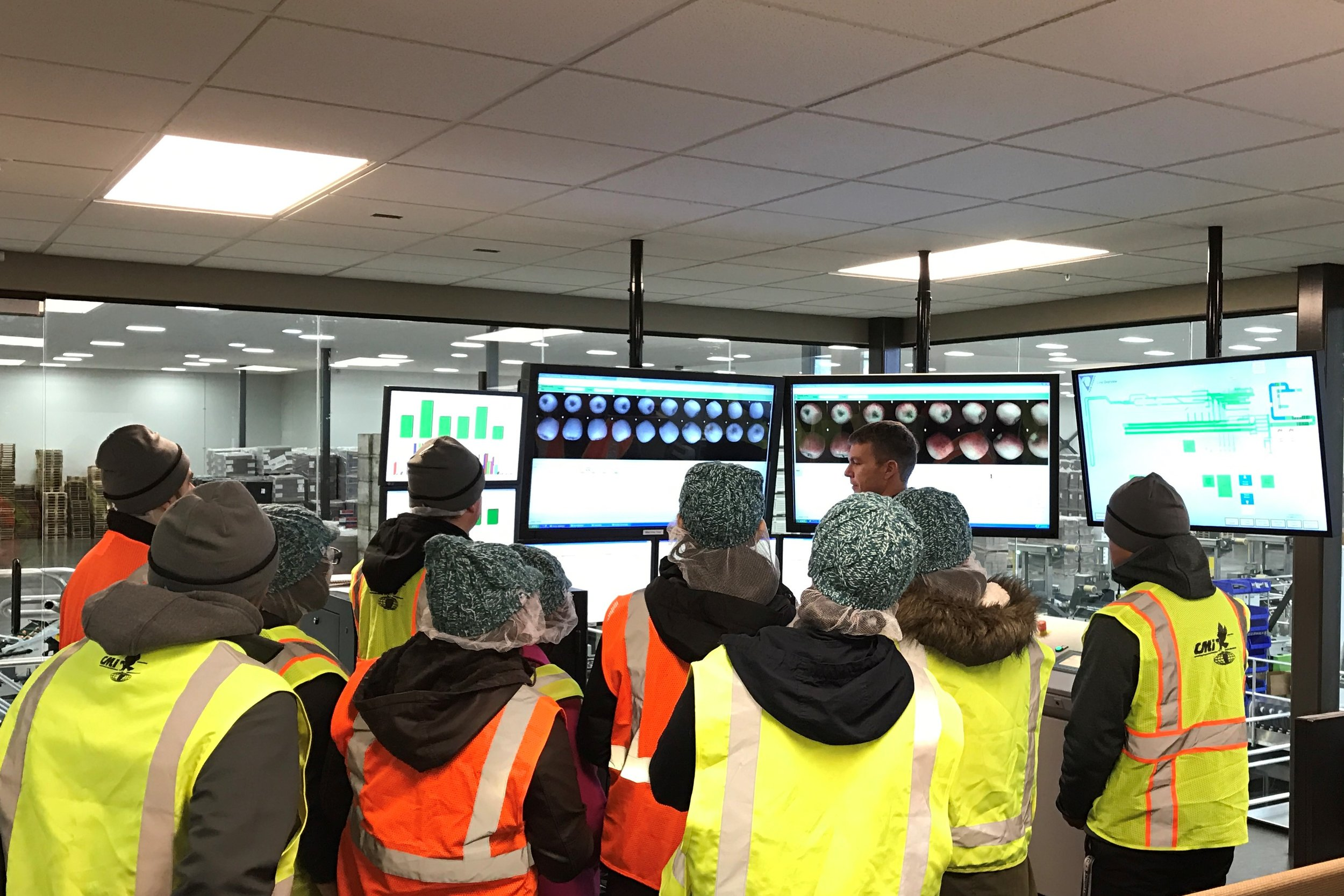 Learning about monitoring and managing apples moving across the high-tech packing lines.