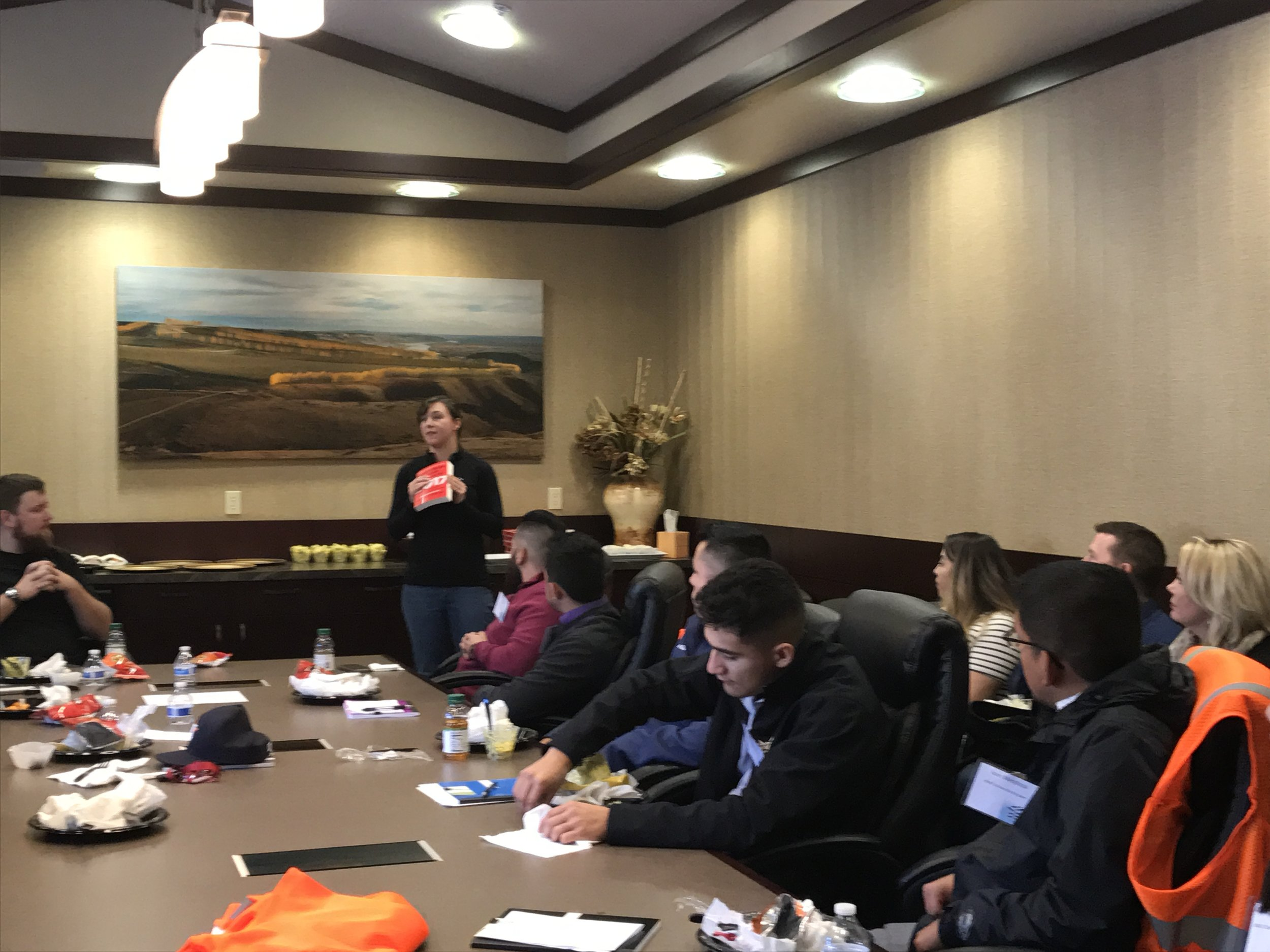 """Over a networking lunch with all of the morning's participants, Allan Brothers' Suzanne Neiman introduced a book that was gifted to each student by Allan Brothers titled, """"What Color in Your Parachute""""."""