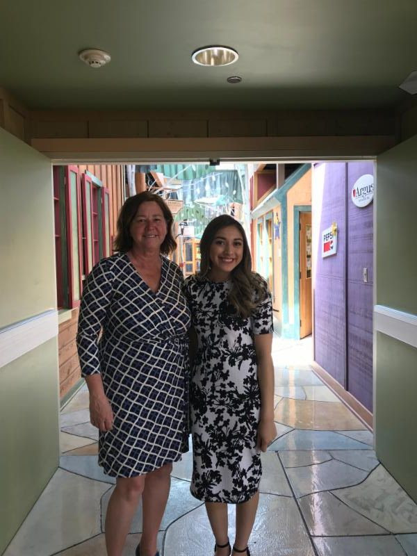 Angelica Hernandez receives a tour of Children's Village from Laura Crooks