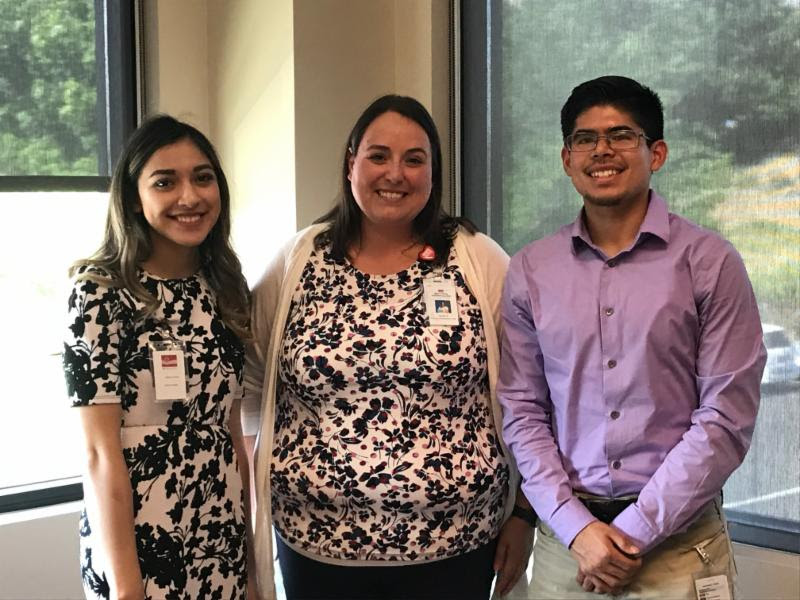 Sandra Saurez meets with students Angelica Herndez and Javier Silva at Yakima Valley Farm Workers Clinic