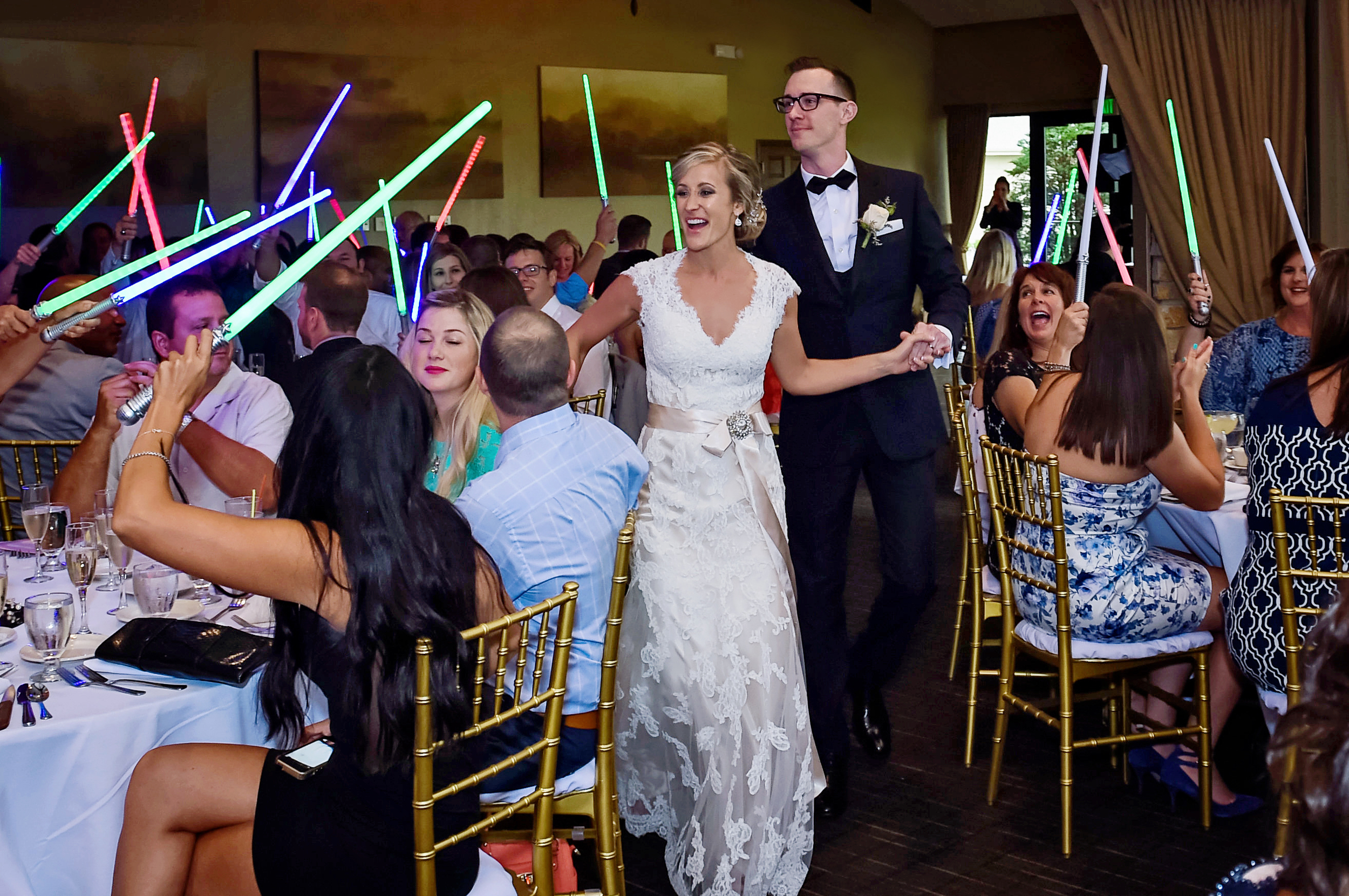 Adam and Erica made their entrance as Mr. & Mrs. to a Jedi worthy salute.