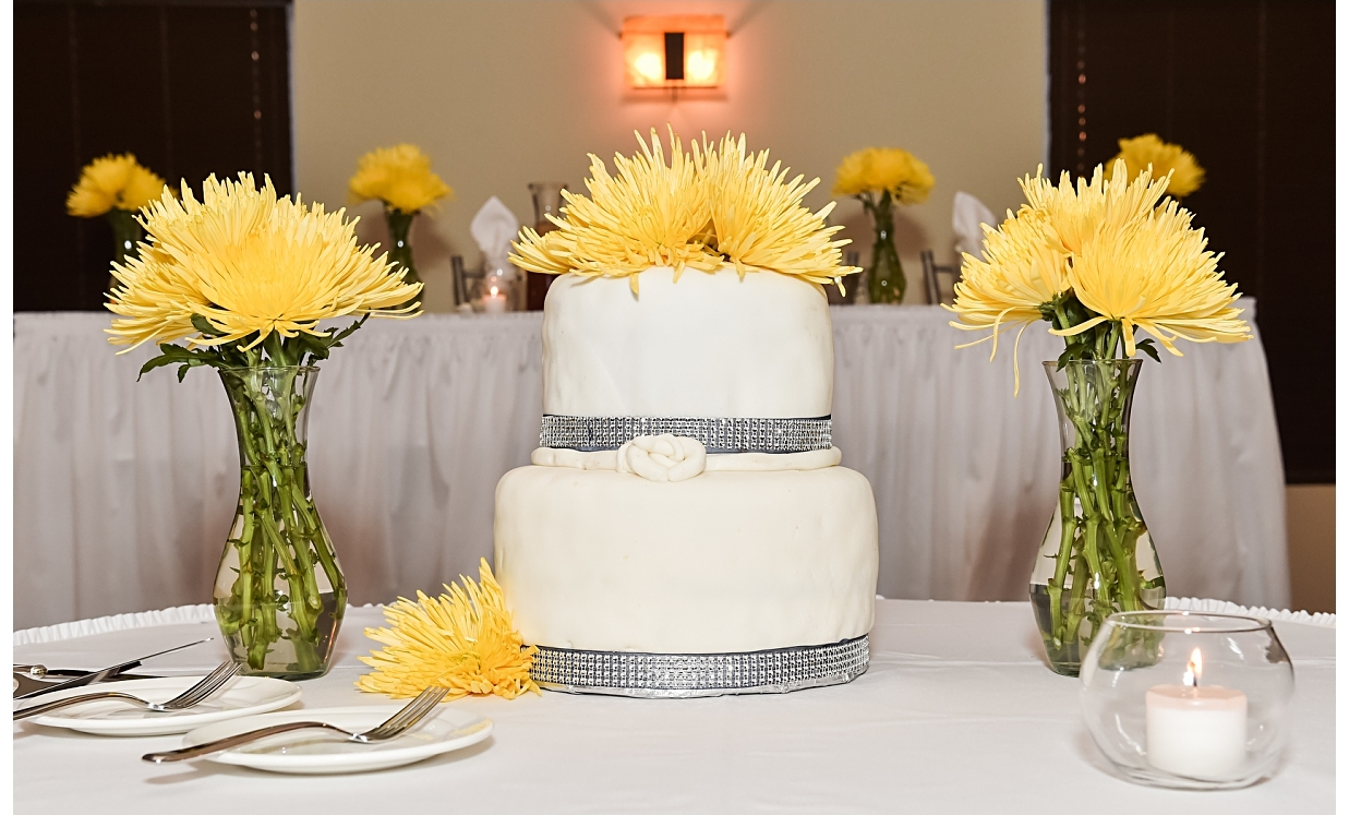 """We purchased the flowers from  East Chicago Florist . Then we arranged the centerpieces ourselves with the help from of some of our bridal party. I chose spider mums because they remind me of fireworks and I love their modern appeal."""