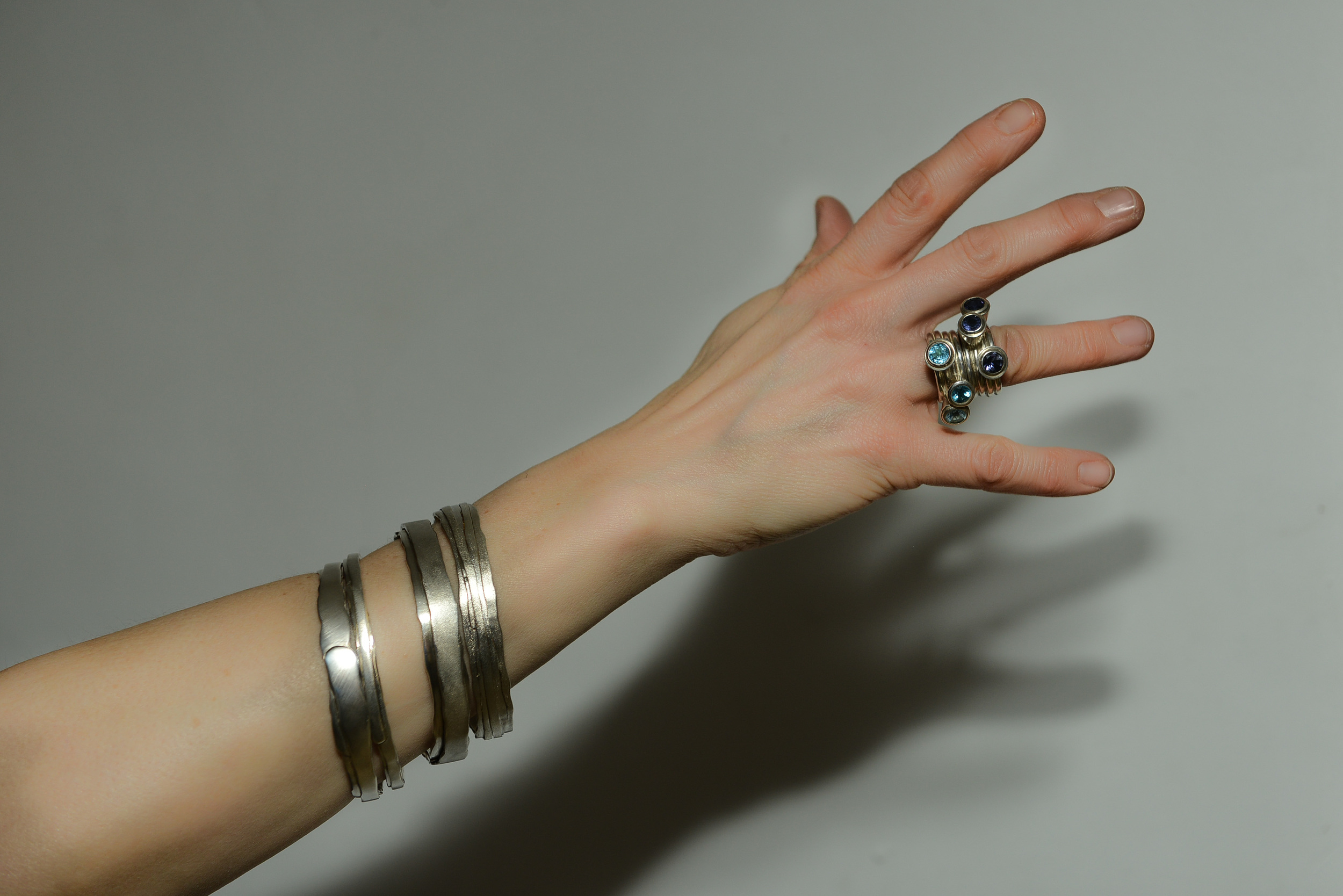Wrapt bangles and tall set rings
