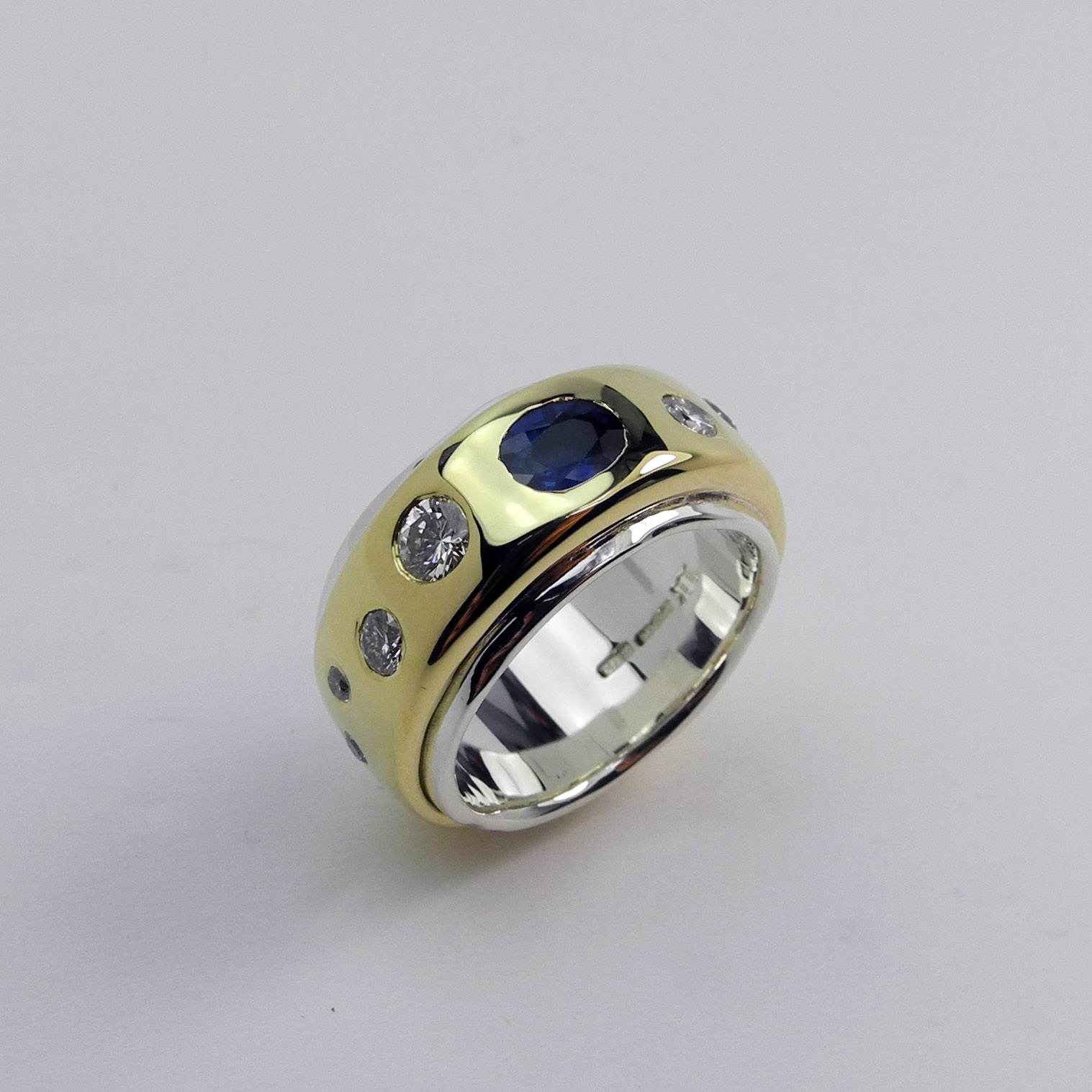 18ct gold around silver with sapphire and diamonds